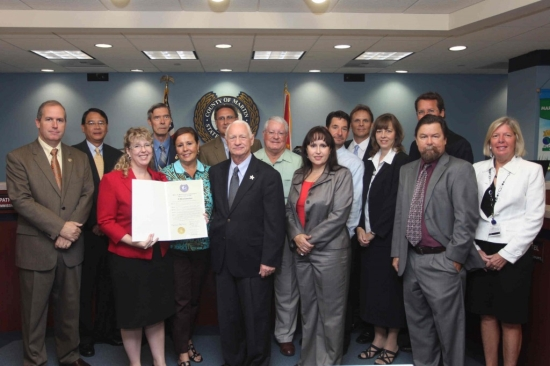 Martin County commissioners, Crary Buchanan attorneys and Mirta Morgan of Florida's Blood Centers with proclamation supporting the law firm's blood drive.
