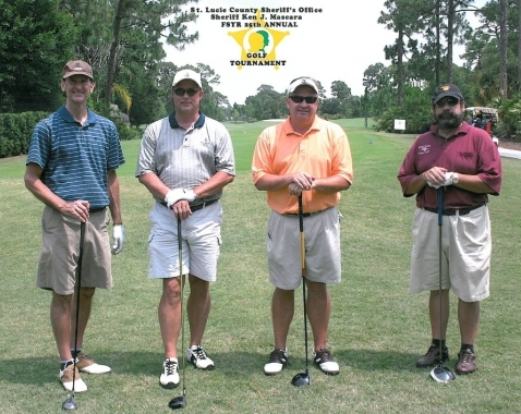 From left, Mike Crary, Scott Wade, Mark Corson and Dr. Hal Tobias