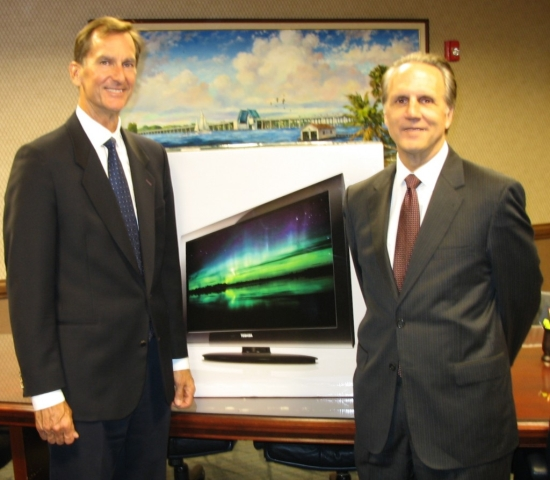 Steven M. Swann, right, presents a flat-screen TV to Mike Crary as a raffle prize for the 9-11 Blood Drive.